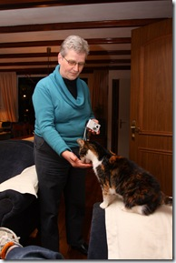 Fem's mum feeding the cat
