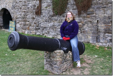 Fem posing on a cannon