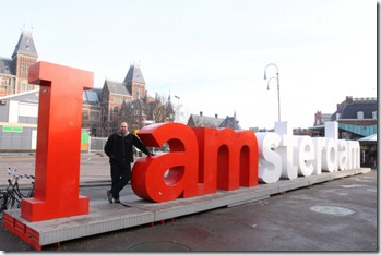 Me with amsterdam sign